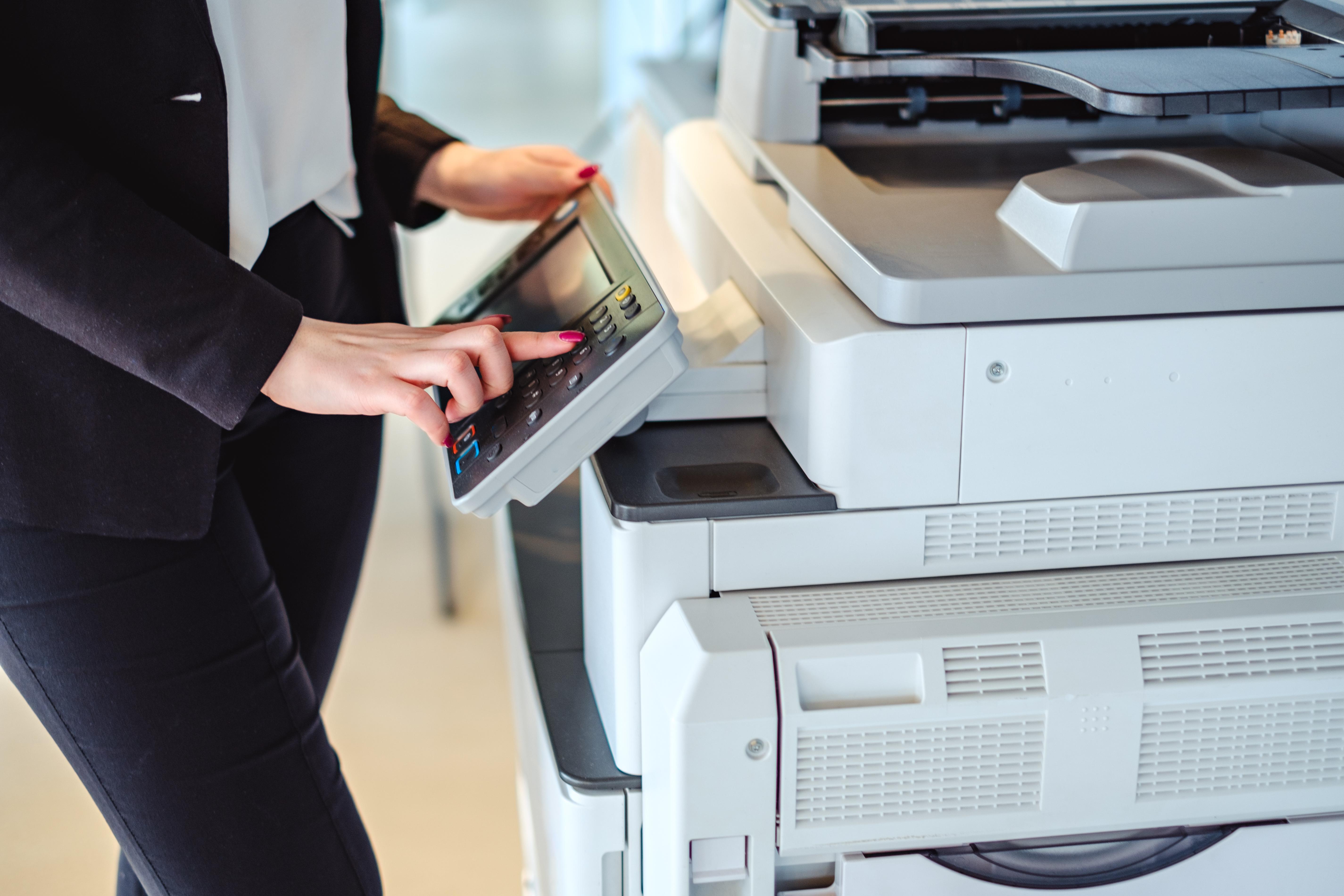 Female financial advisor using a printer.